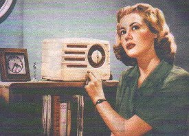 The radio's not that enormous in the image, but her facial expression's perfect