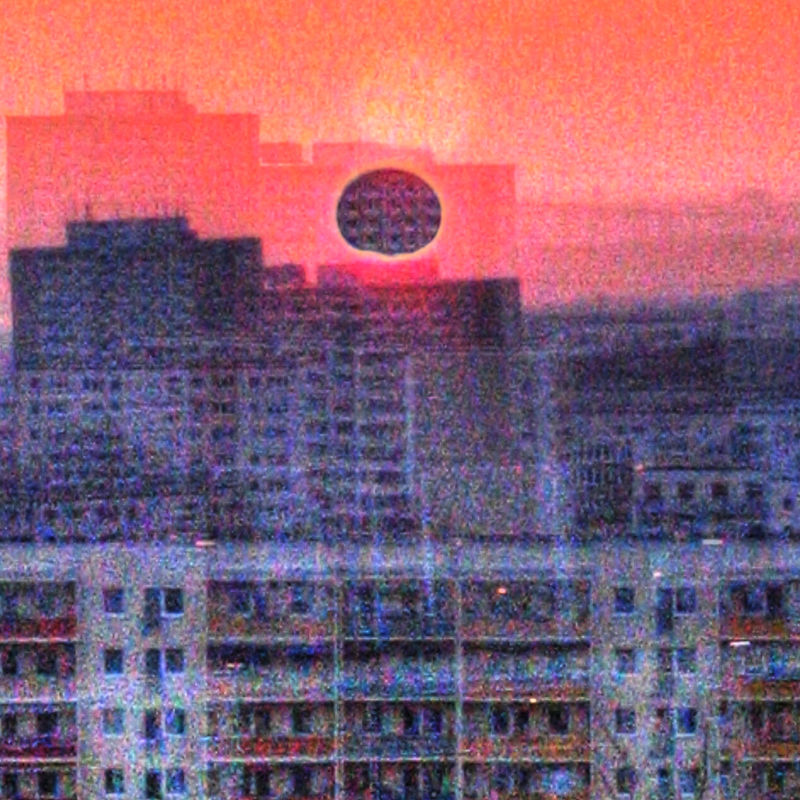 'black square sun hype?Really eclipsed through layers of social housing blocks,' by user hinkelstone on Flickr
